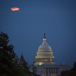 A perigee full moon or supermoon is seen behind clouds over the United States Capitol, Sunday, August 10, 2014, in Washington. Original from NASA. Digitally enhanced by rawpixel. thumbnail