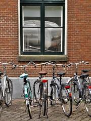 Dutch HWW, with cheese and bicycles (wilma HW61) Tags: raam window fenêtre fenster finestra fietsen ciclo faireduvélo radfahren bicycles vervoermiddel meansoftransport kaas cheese transportmittel fromage formaggio voedsel food hww dwwg groningen nederland niederlande netherlands nikond90 holland holanda paysbas paesibassi paísesbajos europa europe wilmahw61 wilmawesterhoud bike fiets wednesday windowwednesday happywindowwednesday building