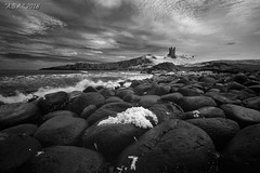 "Dunstanburgh Castle (""A.S.A."") Tags: dunstanburghcastle embletonbay northumberland britain northeast northeastcoast northsea infrared830nm boulders rocks coast seascape sky cloud castle sonya7rinfrared830nm sonyzeissvariotessarfe1635mmf4 blackwhite mono monochrome greyscale niksoftware silverefex asa2018"