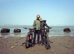Michalina and Bart. Tentsmuir National Nature Reserve, Scotland. (wojszyca) Tags: fuji gsw 680iii 6x8 120 mediumformat fujinon sw 65mm kodak portra 400 pushed epson v800 friends cycling bicycle beach sea couple portrait