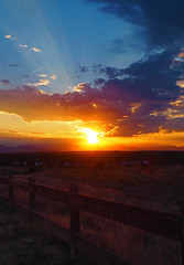 Rocky Mountain Sunset (oceanzam) Tags: mountains scenery forest landscape sun sunset sky cloud color colorful beams light dark shadow night panorama colorado dusk summer blue fence field garden country rockies rockymountains hot evening beautiful bright