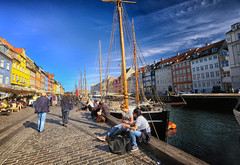 Along the harbor in Nyhavn in Copenhagen, Denmark (` Toshio ') Tags: toshio denmark copenhagen europe european europeanunion danish harbor boat mast restaurant cafe people ship fujixt2 xt2