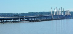 The ruins of the semi demolished old Tappan Zee Bridge. Only a small portion of the long causeway still exists. The pavement is gone, but some of the supports remain. The center span isn't connected to anything on either side. New York. June 2018 (wavz13) Tags: oldbridges vintagebridges modernbridges newbridges highways freeways hudsonvalley hudsonriver westchestercounty rocklandcounty newyorkthruway newyorkthroughway newyorkstatethruway newyorkphotography highwayphotography bridgephotography newyorkphotos highwayphotos bridgephotos construction constructionsites bridgeconstruction newyorkbridges hudsonriverbridges cars infrastructure newyorkhighways abandonedbridges demolition
