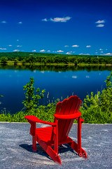 Nothin' Better'n One Red Muskoka Chair (jah32) Tags: red cmwdred colour color colours colors colourful summer summertime summercolours summercolour summerskies blue fredericton newbrunswick canada chairs chair muskokachairs muskokachair adirondackchairs stjohnriver water river rivers