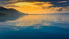 Burning Reflections (Alfred Grupstra) Tags: nature lake water landscape mountain sunset scenics sky sea summer reflection outdoors blue beautyinnature tranquilscene island cloudsky travel dusk nopeople ohridlake macedonia