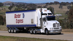 You can always find a BORDER EXPRESS (3/4) (Jungle Jack Movements (ferroequinologist)) Tags: fleet border express sydney melbourne albury table top hume highway jerrawa yass triaxle cadeb anthony tony ryan preanvis kenworth volvo nose cabover white hp horsepower big rig haul haulage freight trucker drive transport carry delivery bulk lorry hgv wagon road semi trailer deliver cargo interstate articulated vehicle load freighter ship move roll motor engine power teamster truck tractor prime mover diesel injected driver cab cabin loud rumble beast wheel exhaust double b grunt