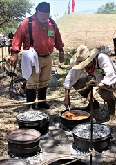 Pioneer cooking (miosoleegrant2) Tags: pioneercooking outside food man male cowboy cook hat boots butch guy gentleman festival folklife texas tx texasfolklifefestival sanantonio camp campfire fire wilderness dutch0ven frontier iron west wildwest castiron men guys dude studly manly dudes handsome face profile stud working arms condid unware unexpected portrait facial hunk sexy masculine people persons event annual ethnicities instituteoftexancultures culture celebration lonestar ethnic grass whiskered bewhiskered chaetophorous unshaven beardy barbate