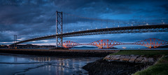 The Forth Bridges (ianrwmccracken) Tags: forthroadbridge flat d750 landscape pier reflection lowlight evening nikkor2470mmf28 suspension nikon cable forthbridge scotland bluehour steel tower cantilever shore sky lowtide mud coast concrete metal