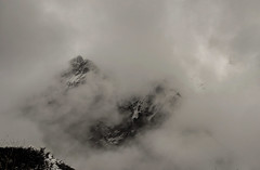 Shrouded (sakthi vinodhini) Tags: settlement annapurna nepal himalayas abc trek backpack mountains hills ngc landscape mountain dark deep bamboo wet rainy grass hdr storm wind rain elements rocks mist fog sky mountainside snow snowfall rock peak machchapuchhre mbc