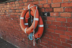 43 (natlou_2506) Tags: lifepreserver rings life preserver newbrighton wirral wallasey promenade nikon nikond3300 d3300 amateur photographer wall rope boats savelives water sea ocean help orange white brick number 43