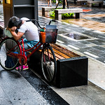 Man sleeping on his bicycle seat, Taipei, Taiwan thumbnail