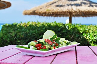 #Quinoa Salad with cherry Tomatoes, diced Cucumber, Onion, Avocado, dressed with fresh lime juice, vinegar and virgin olive oil, parsley and mint. Served with the best sea view! Enjoy! #CoconesBeachBar #Cocones #Polichrono #Chalkidiki #Cocktail_Bar #Food