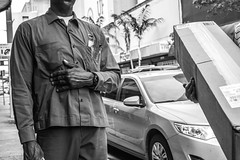 Stand and Deliver (Michael Goldrei (microsketch)) Tags: festival street deliver bw standing 2016 monotone photos leica monochrome st photography black heart miami parcel downtown photo monochrom ups hands delivery florida stand december hand blackandwhite grey dec white 16 greyscale btw photographer m fl