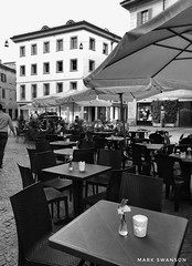 Ready for Dinner (mswan777) Tags: travel world sky mobile iphone iphoneography apple blackwhite white black monochrome italy varese architecture brick window building outdoor evening umbrella street cafe candle chair table