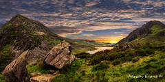 Welsh Mountains Snowdonia (Adrian Evans Photography) Tags: welshvista llynogwen cwmidwal ogwenlake landscape snowdonianationalpark welshmountain welshlandscape landmark mountains wales outdoor tryfanmountain valley rocks welshvalley ogwenvalley penyrolewen scenicview sunset sunrise snowdonia uk adrianevans northwales tryfan sky panorama heather lake clouds glyderaumountains nikon d800 20mm