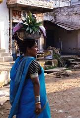 Offerings (pam's pics-) Tags: india travels worldtravel pamspics pammorris asia woman street offerings fish sari colorful onthewaytothetemple religion religious benares varanasi inthestreet nocluewhatcameraiused filmshots scanned scan