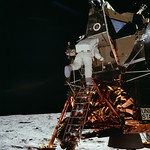 Astronaut Edwin E Aldrin Jr, Lunar Module (LM) pilot descends from the LM, climbing down the ladder. Original from NASA. Digitally enhanced by rawpixel. thumbnail
