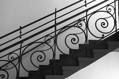 Way up (Elbmaedchen) Tags: geländer treppengeländer schnörkel railing upstairs stufen steps blackandwhite schwarzweis