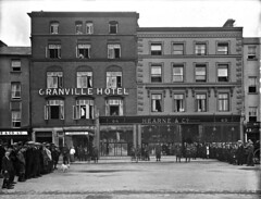 Shop at Hearne's - Lunch at the Granville (National Library of Ireland on The Commons) Tags: ahpoole arthurhenripoole poolecollection glassnegative nationallibraryofireland waterford thequays hearnesdepartmentstore thegranvillehotel military civilians street dog irishcivilwar commins commercial hotel siegeofwaterford coloneljohntprout civilwar irishfreestateoffensive munsterrepublic bulletholes granvillehotel hearne