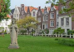 Pious Holland (yon_willis) Tags: amsterdam nederland noordholland holland begijnhof europe 2014 thenetherlands courtyard catholicism townhouses statue northholland lawn