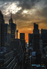 After the Midtown Storm (hilarybachelder) Tags: storm thunderstorm skyline afterthestorm rain terrace a7rii above composition cityscape city clouds cloud dof depthoffield edge 35mm eerie eastside fullframe frame focus dramatic goldenhour golden illuminated july leadinglines light bank america bankofamerica 44thstreet yaleclub roof rooftop lines mirrorless manhattan magical endofthestorm nyc overcast prime pov pointofview sony sonya7rii season sky vantagepoint viewpoint weather wideangle yellow orange grey midtown vanderbiltave sigma sigmaart