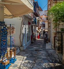 Shopping Street - Skopelos Town (Olympus OM-D EM1-Mk2 & M.Zuiko 12-100mm f4) (1 of 1) (markdbaynham) Tags: greece greek hellas hellenic greekisland skopelos skopelostown sporades sporadesisland grecia greka gr town urban olympus omd olympusomd olympusgreece em1 em1ii em1mk2 csc mirrorless mft evil m43 microfourthird microfourthirds micro43 m43rd mzd zd mzuiko zuikolic micro43rd street 12100mm f4 prozoom travelzoom travel greekholiday vacation