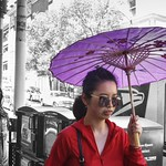 Chinese woman with umbrella thumbnail