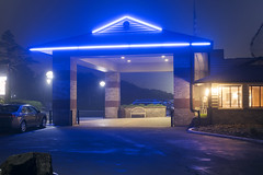 Best Western (Curtis Gregory Perry) Tags: lincolncity oregon blue neon night hotel lodging awning parking lot long exposure nikon d810 building architecture light dark car