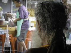 The observer (stormymayen) Tags: observer vendor beard earing curlyhair cola drinks