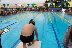 Starting Blocks - Rainy Swim Meet (aaronrhawkins) Tags: swim swimming race meet freestyle contest start blocks time timer begin flags boy rainy rain pool lane summer jump prepare anticipate anticipation provo utah joshua aaronhawkins riverside country club child children