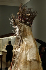 Yves Saint Laurent's statuary vestment for the Virgin of El Rocío, circa 1985, with gold silk brocade and pearls (detail) (battyward) Tags: fashion met couture heavenly bodies catholic imagination nyc