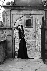 Gatekeeper in black (piotr_szymanek) Tags: karolina karolinak blackandwhite portrait woman dress transparent young skinny milf gate castle