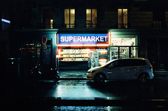 (fritz london) Tags: pentaxk1000 cinestill800t smcpentax28mmf35 35mm color tungsten film night paris france neon pigalle supermarket