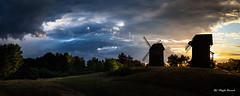 Summer Elements (Magda Banach) Tags: 19thcentury canon moraczewo windmill afterstorm blue clouds colors dramatic evening field greaterpoland green koźlak landscape nature outdoor outside panorama plants poland silhouette sky summer sunset trees