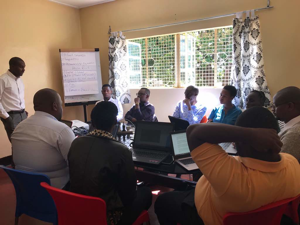 Project Manager, Mr. Adam R. Mbyallu, giving a project overview of Inspire100 project to the team, at Mkwawa Community Art Space in Iringa, Tanzania. Photo credit: Emmanuel Senzighe