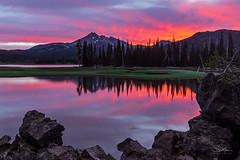 A Sparkler at Sparks (TierraCosmos) Tags: sparkslake lake mountain brokentop sunrise dramaticsky reflection rocks oregon centraloregon colorfulsky landscape
