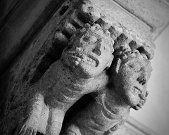 Twins (Anne Marie Clarke) Tags: twins medieval stone carving monastery flickrfriday 7dwf monochrome blackandwhite french stonecarving teeth fingers mouths cloisters thursdaysrules symbiosis gargoyles