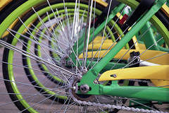 Limes (Jetcraftsofa) Tags: pentaxspotmaticsp helios442 superia400 35mm slr filmphotography availablelight publictransit bicycles concentriccircles spokes chains lime