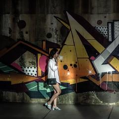 Walking Through (mark-marshall) Tags: chicago streetscenes women candidmoments graffiti murels streetart shadows hss