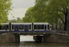 Streetcar and bicycles (JLM62380) Tags: streetcar bicycles amsterdam amsterdamer urban urbain ville city pont bridge arbre tree