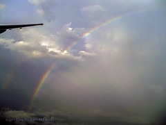 Dashing through the Rainbow 2011 (Greg Reed 54) Tags: rainbow cloud clouds thunderstorm thunderstorms storm storms rain flight aviation aerial dhc8 dash8