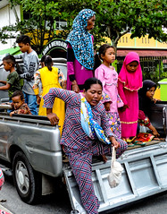 Dismounted (A. Yousuf Kurniawan) Tags: woman children kidworld colourstreetphotography colourful streetphotography decisivemoment urbanlife borneo pangkalanbun kalimantan people contrast