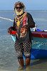 Di Old Mon And Di Sea (Poocher7) Tags: boat sea people portrait man fisherman sunglasses lighter rastaman dreadlocks beard fishingboat fishingpole tshirt shorts paisleyprint water ocean caribbeansea mobay montegobay jamaica jamaican westindies caribbean wading leopard