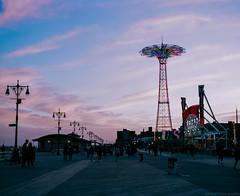 Coney Island Sunset (GPhace) Tags: 120mm 90mmt38 boardwalk brooklyn coneyisland denoswonderwheel lunapark mamiya mediumformat nyc rb67pros sekor summer magichour nightphotography nightshots sunset