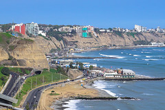 On the ocean / На берегу океана (Vladimir Zhdanov) Tags: travel peru sky lima miraflores ocean water wave road city car architecture rock landscape building cliff tree beach