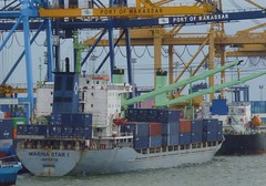 Busy port (Ben Zabulis) Tags: sulawesi celebes southsulawesi indonesia asia southeastasia maritime nautical marine transport container marinastar1 quaysidecrane boom jib crane gantry engineering structuralengineering port harbour fareastexplorer column beam brace 5photosaday hull superstructure sea portofmakassar stern civilengineering