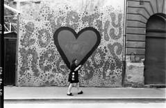 I love my phone.. (nextstopbombay) Tags: kodaktrix400 nikonf6 d76 hungary budapest phone blackandwhite monochrome bw street heart graffiti walking