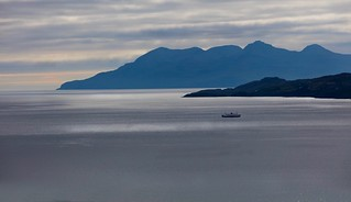 The Road  to Doune. Looking towards the Isle of Skye from Knoydart as the  Mallaig to Armadale makes its way.