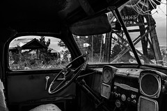 024693763535-102-Take the Wheel-6-Black and White (Jim There's things half in shadow and in light) Tags: 2018 america canon5dmarkiv eldoradocanyon july miningtown mojave nelson nevada nevadacameraclubfieldtrip southwest tamron2470mmf28divcusdg2 usa clouds cloudy desert ghosttown stormy summer steeringwheel truck cab blackandwhite