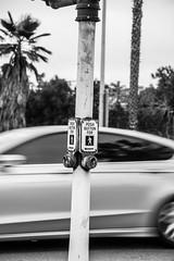 Push to Cross (benakersphoto) Tags: sandiego sandiegocalifornia sign motion blur car movement button crosswalk street sidewalk city blackandwhite black white blackwhite bw nikon nikkor flickr outside transport transportation bnw